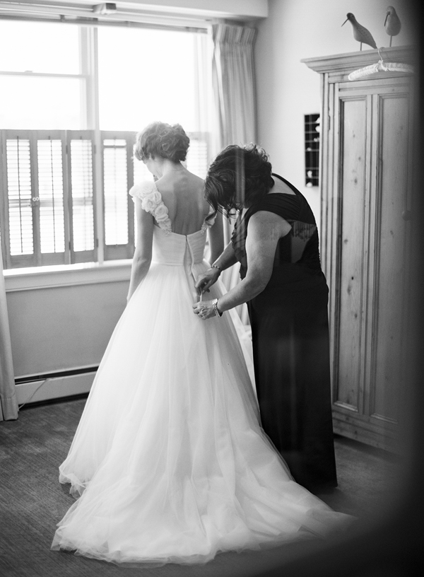 mom helping with wedding gown